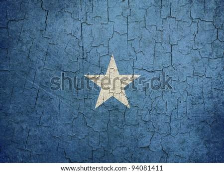 Somalian flag on a cracked grunge background - stock photo