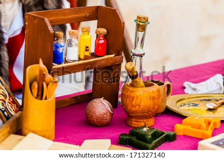 some aromatherapy or alchemic items on a table - stock photo