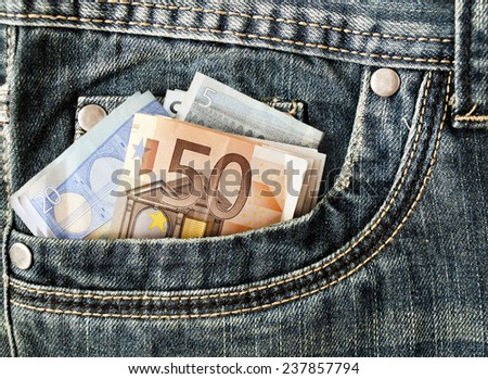 some banknotes in the pocket of jeans - stock photo
