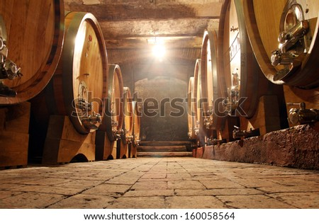 Some barrels in a  cellar - stock photo