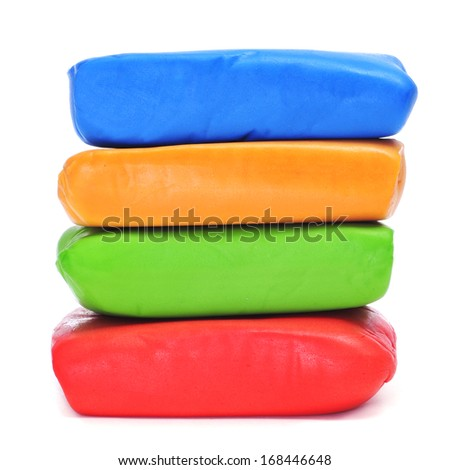 some bars of rolled fondant of different colors on a white background - stock photo