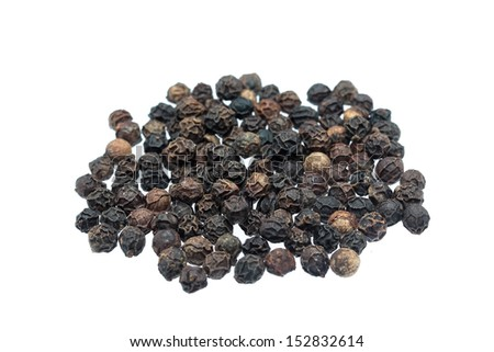 some black peppers on a white background - stock photo