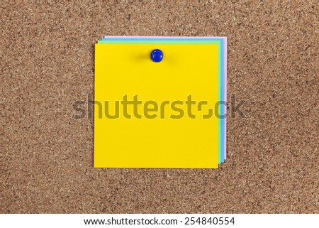 Some blanks post-it notes on cork board (bulletin board). - stock photo