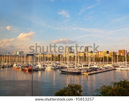 Some boats in  Barcelona port at the sunset - stock photo