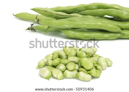 some broad bean pods and some broad bens isolated on a white background - stock photo