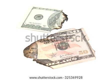 some burnt dollars banknotes on white background