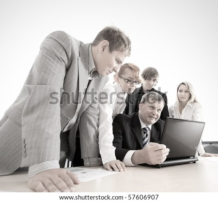 Some business people at work over blue background - stock photo
