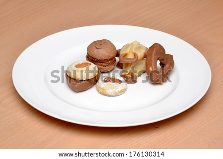Some cakes on a plate  - stock photo