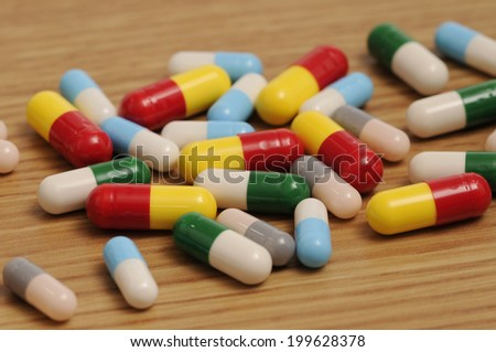 Some capsules and pills on white background