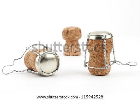 Some champagne corks close-up on white background - stock photo
