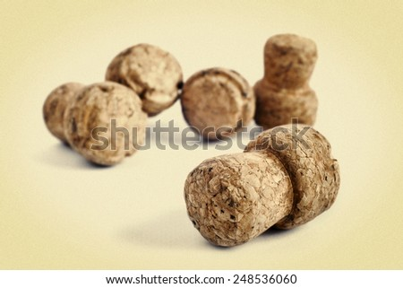 Some champagne corks close-up on white background. picture in retro style - stock photo