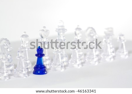some chess on white board with blue queen