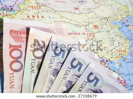 Some Chinese bank notes on a Chinese map of China. Chinese currency is called the RMB or Yuan - stock photo