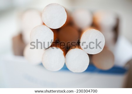 Some cigarettes with filter - stock photo