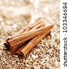 Some Cinnamon Sticks on a shiny golden background for wintery food concepts - stock photo