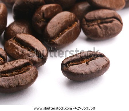 Some coffee beans are on the white background.