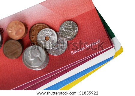 Some coins on savings account passbook.