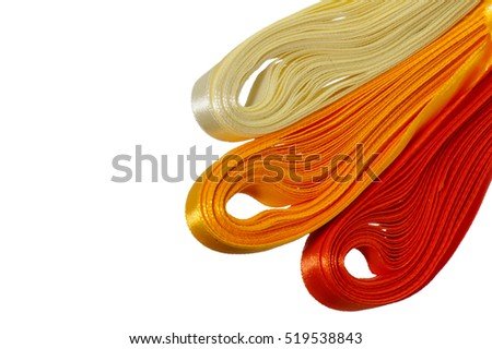 some colored satin ribbons on white background