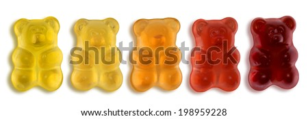 some colorful gummy bears in light back - stock photo