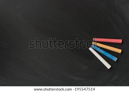 some colorized chalk on blackboard background - stock photo