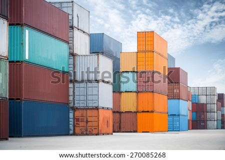 some container stacking in freight yard ,transport concept - stock photo