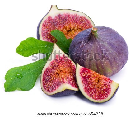 Some cut parts of ripe fig with juicy pulp and the green leaf isolated on white background. - stock photo