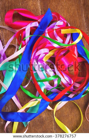 some decorative colored ribbon on wooden background