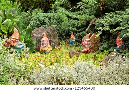 Some decorative gnomes, decorating a yard - stock photo