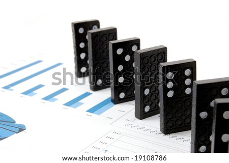 some domino stones on a blue  business chart