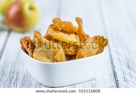 Some dried Pears (selective focus, close-up shot) on wooden background