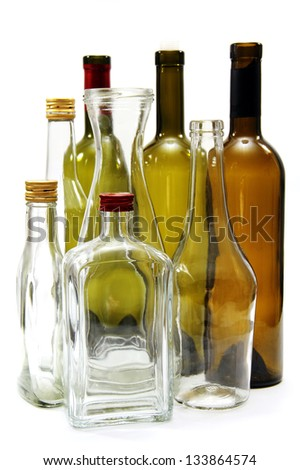 some empty glass bottles from under the wine and spirits. - stock photo