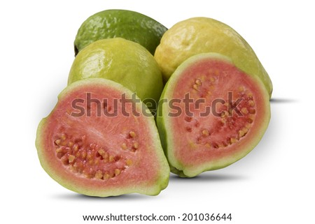 Some entire red guavas and a guava cut in a half on a white background - stock photo