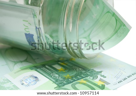 some 100 eur banknotes in jar over white isolated background - stock photo