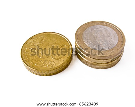 Some euro coins in piles: 50 cents pile and one euro pile - stock photo