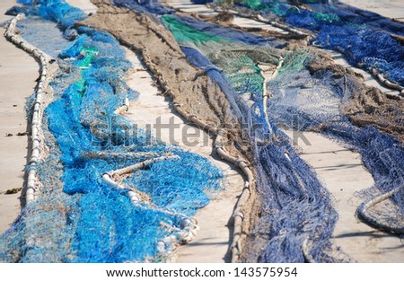 Some fishing nets on the floor - stock photo