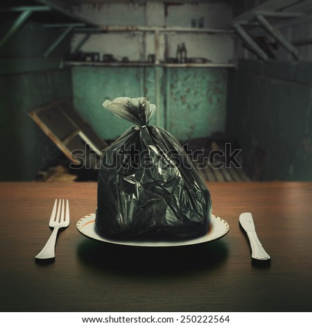 Some food in the garbage package - stock photo