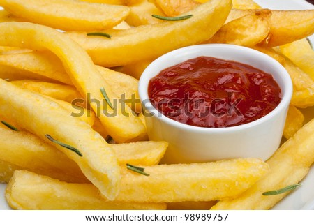 some french fries with ketchup served on a plate