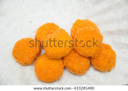Some fresh chicken nuggets on a white background - stock photo