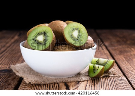Some fresh Kiwi Fruits (selective focus) on an old wooden table