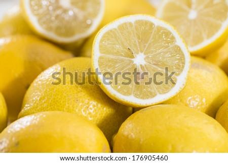 Some fresh Lemons on vintage wooden background - stock photo