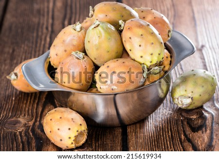 Some fresh Prickly Pears (detailed close-up shot) on wooden background - stock photo