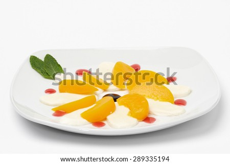 Some fruit on white plate. Isolated on white background. - stock photo