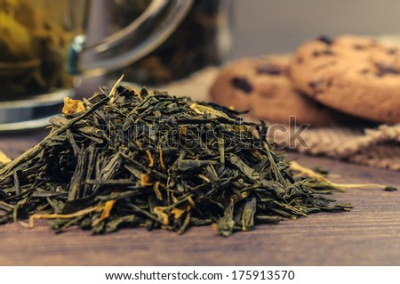 Some green tea and cookies on the background - stock photo