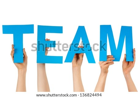 some hands holding the charakters TEAM in blue, isolated - stock photo