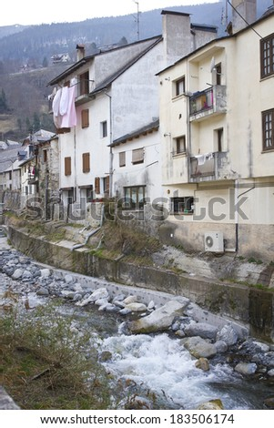 Some houses of the old town in Aran close to the river. Catalonia.