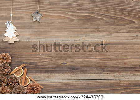 Some items for christmas on a wooden table. - stock photo