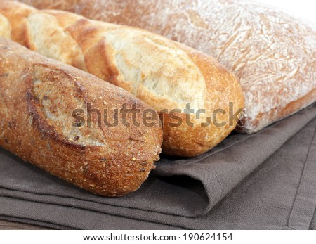 some kind of rustic bread display in market place - stock photo