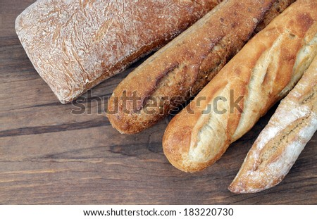 some kind of rustic bread on the table - stock photo