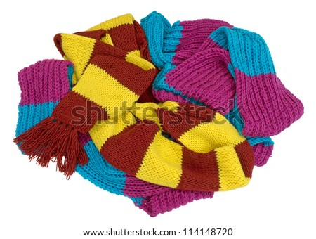 some knitted scarves laid in a bunch