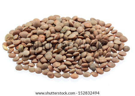 some lentils on a white background - stock photo